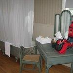 Claw-foot tub in the bathroom, plush towels.