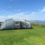 our tent piched up on the cliff edge