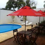 The unsafe pool area with 2 cheap hard plastic chaise lounges no cushions,no table to put drinks