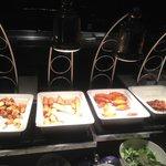 From left: Deep fried prawn moneybag, deep fried veggie spring roll, sugar cane prawn and Satay