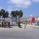 Ornos beach bus stop (in front of man). taxi boat tickets from shed in front of motorbike