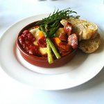 spanish inspired breakfast of baked tomato, egg, haloumi cheese, chorizo, asparagus and sourdoug