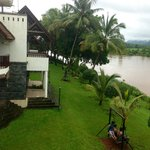 View of rooms, lawns and river  from balcony