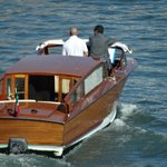 Take a water taxi to the hotel.  15 min walk from the Airport to the taxi port