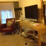 Chair, table and a TV in the room