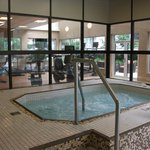 Large hot tub with exercise room beyong