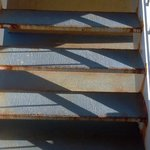 Unequal stair riser height. Use the handrails!