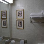 Fresh towels, tiles, pictures in the bathroom