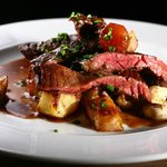 Bucher cut steak on crispy potatos in red wine sauce
