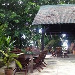 Breakfast patio, near the smaller pool & Berembun
