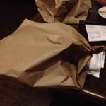 this is the way the wrap the leftover pizza, brown papaer bag. I've only seen this in the Waterb