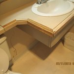 bathroom sink vanity in terrible condition