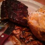 Ribs, chicken and loaded baked potato