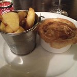 Chicken, leek and black pudding pie with chips