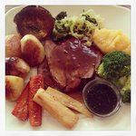 Delicious Roast lamb lunch complete with herby Yorkshire pud and an extra jug of gravy! Yummmmmm