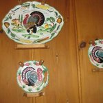 Vintage turkey plates adorn the knotty pine walls
