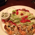 wedge salad with grilled shrimp and dressing on the side