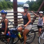 family on a bridge over Animas