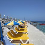 Beds on breakwater at Amadores beach 20 euros for 4 beds and 2 parasols, worth it !!