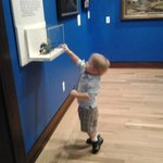 my son checking out an antique toy
