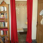 Only a drape of cloth separates bathroom and bedroom
