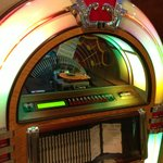 I do like the jukebox. In some booths, you can can pay (very inexpensively) to select songs.