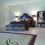 Honeymoon Suite with en-suite spa bath & shower. Large flat screen TV & DSTV. Bar fridge.