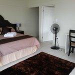 Executive Room with en-suite spa bath & shower. TV & DSTV. Bar fridge. Magnificent views