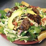 Salad with grilled filet mignon, avocado, grilled corn, black beans, cheese and tomato