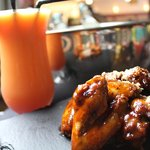 Oasis special Wings, with a cocktail