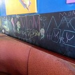 chalkboard & chalk for kids in booth. A great idea.