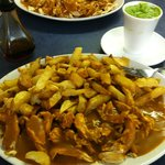 Chicken curry with chips and mushy peas