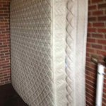Old mattresses stored in a main stairway (to get more mildew?)