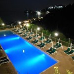The pool and back of the hotel by night