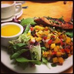 salad with mango, tomatoes and salmon - dressing on the side