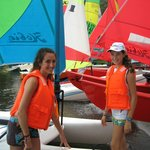 Younger sister teaching older sister to sail