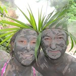 Wearing mud and palm crowns.