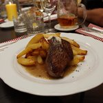 Beef Steak in light butter sauce, served with baked potato