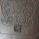 sacred heart carving on door