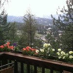 Romantic table for 2 on outdoor balcony looking at Rockies.