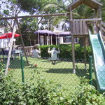 Children's play area with slide and swings