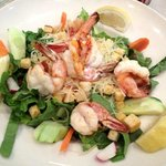Grilled Shrimp over Caesar Salad