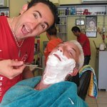 Andy getting a shave by Curly in hotel hairdressers