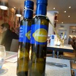 Own brand of olive oil that can be purchased within the restaurant