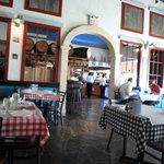 Dining room and bar/kitchen/dessert area afar