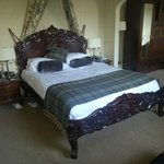 Ornate wooden sleigh bed