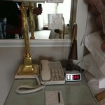 is that phone antique? no, it's just old... and digital clock is kind that you find in some barg