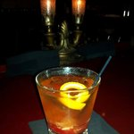 Old Fashioned  in front of the cool bar lights