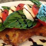 Chicken Milanese topped with a Caprese Salad