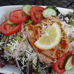 A salad with salmon, beautifully presented
